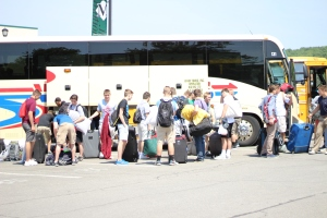 Boys unload their gear from the buses before preparing for their first night at SUNY Morrisville.